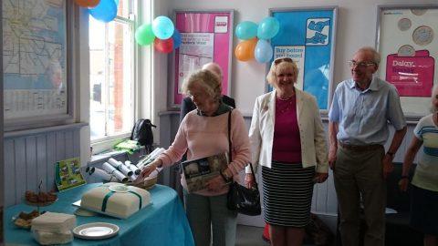 Cllr Elizabeth Thomas cutting the celebration cake